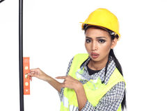 Asian Architect Engineer woman in yellow hard hat,  safety vast Stock Images