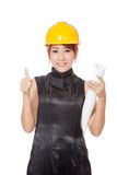 Asian architect girl hold plan show thumbs up Stock Photo