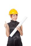 Asian architect girl wear hardhat and show a plan and thumbs up Royalty Free Stock Photos