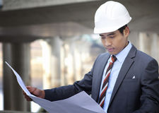 Asian architect on highway construction site Royalty Free Stock Images