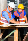 Asian architect and supervisor on building site Royalty Free Stock Photography