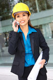 Asian Architect at Work. A pretty asian architect woman at building site on phone Stock Photography