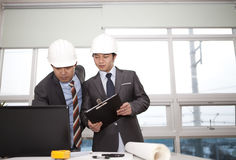 Asian architects working on planning Stock Photography