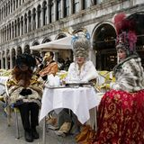 Asian aristocratic women for carnival of venice. Historic building on the background. VENICE, ITALY Royalty Free Stock Images