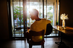 Asian artist man play guitar in cafe sunlight Royalty Free Stock Image