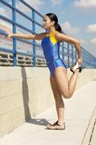 Asian Athlete Woman Stretching On Track And Field Stock Photo