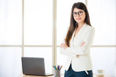 Asian attractive businesswomen arms crossed standing in office Stock Photos
