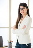 Asian attractive businesswomen arms crossed standing in office Stock Image