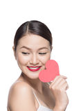 Asian attractive smiling woman isolated on white with heart.  Stock Photography