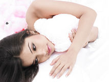 Asian babe with her teddy bear. In bed Stock Photos