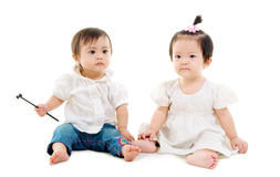 Asian babies. Lovely asian babies sitting on the floor Stock Image