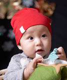 Asian baby. Cute asian baby in a red hat Stock Photos