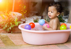 Asian baby Bathing in tubs stock image