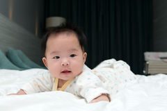 Asian baby on bed Stock Images