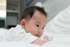 Asian baby on bed royalty free stock photos