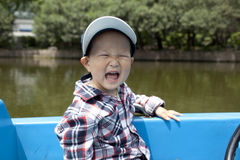 Asian baby boating in the lake Stock Image