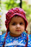 Asian baby in bonnet Stock Photos