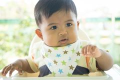 Asian baby bored with food. Cute asian baby bored with food royalty free stock photography