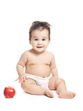 Asian baby boy with apple Royalty Free Stock Photos