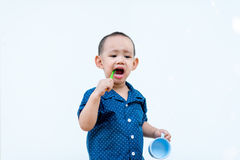 Asian baby boy brushing teeth stock image