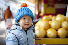 Asian baby boy buying the fruit pomelo Royalty Free Stock Images