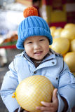 Asian baby boy buying the fruit pomelo Stock Photos