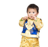 Asian baby boy with chinese costume and finger point to face Royalty Free Stock Photos