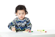 Asian baby boy concentrate on drawing. Isolated on white Royalty Free Stock Images