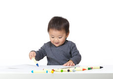 Asian baby boy concentrate on drawing. Isolated on white Royalty Free Stock Photo