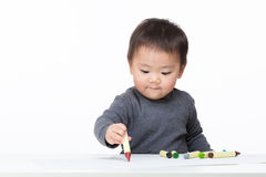 Asian baby boy concentrate on drawing Stock Photo