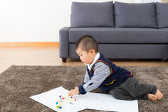 Asian baby boy drawing Royalty Free Stock Image