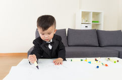 Asian baby boy drawing Stock Photos