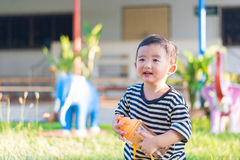 Asian baby boy drink with water bottle at outdoor playground, Royalty Free Stock Photos