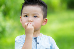 Asian baby boy eat finger food. Asian baby boy eat with finger food royalty free stock images