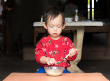 Asian baby boy eating fried rice by spoon by him self Stock Images