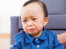 Asian baby boy feeling sad Stock Photos
