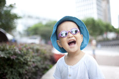 Asian baby boy happy with glass and hat Royalty Free Stock Photo