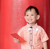 Asian baby boy hold red envelope or Ang-pow . Stock Images