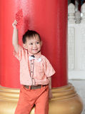 Asian baby boy hold red envelope or Ang-pow . Stock Photography