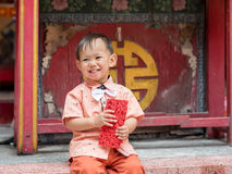Asian baby boy hold red envelope or Ang-pow . Stock Photo
