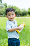 Asian baby boy hold water bottle. Asian baby boy hold with water bottle stock photo