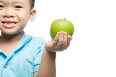 Asian baby boy holding and eating red apple, isolated on white Stock Image