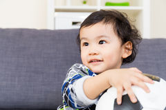 Asian baby boy holding soccer ball Stock Image