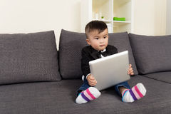 Asian baby boy holding tablet Stock Photos