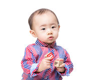 Asian baby boy holding toy block Stock Photo