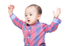 Asian baby boy holding wooden toy block and hand up Royalty Free Stock Image