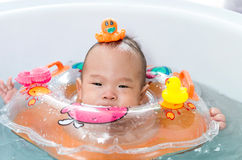 Asian baby boy in kiddie pool with rings Royalty Free Stock Photography