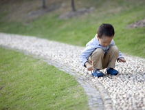 Asian baby boy playing in the park Stock Image
