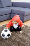 Asian baby boy playing soccer ball Royalty Free Stock Image