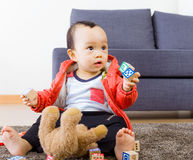 Asian baby boy playing toy block Stock Image